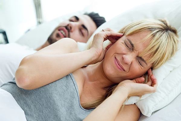 Does Your Partner Have a Snoring Problem? Here's What You Can Do